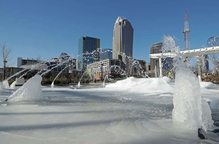Deadly cold disrupts US; warming centers open in Deep South  - January 2, 2018.  Water squirts from a frozen fountain near downtown in Charlotte, N.C., Tuesday, Jan. 2, 2018. Temperatures plummeted overnight to 2 degrees in the north Georgia mountains, 14 in Atlanta and 26 as far south as New Orleans as the Gulf Coast felt more like Green Bay. (AP Photo/Chuck Burton)