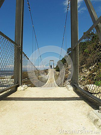Man walking on Storms River Suspension Bridge at Tsitsikamma National Park, area of Garden Route National Park, on South Africa's southern coast