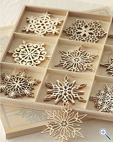 Laser cut snowflake ornaments this would be the cutest thing ever if you had a winter wedding before Christmas so the guest could have a souvenir to hang on the tree :)