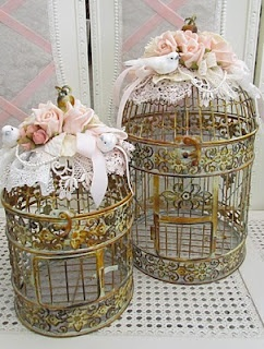 So beautiful! Bird cages decorated with doilies and flowers.