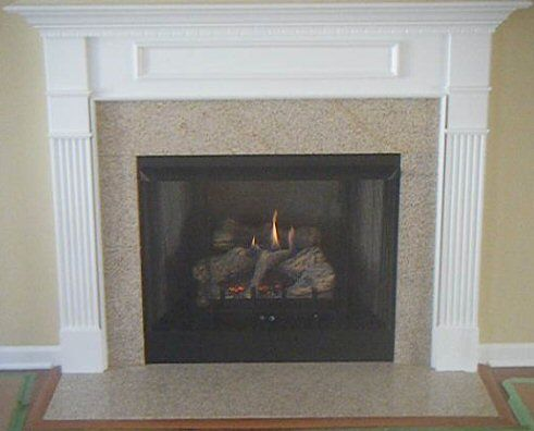 Wheatfield Granite Fireplace Surround With Dogwood Style