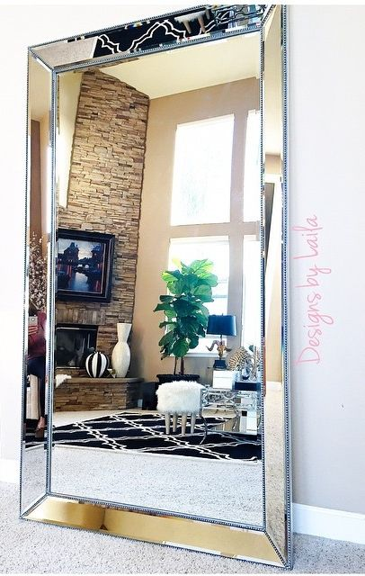 stunning Omni Leaner Mirror in her home. We love how it expands her living  room!