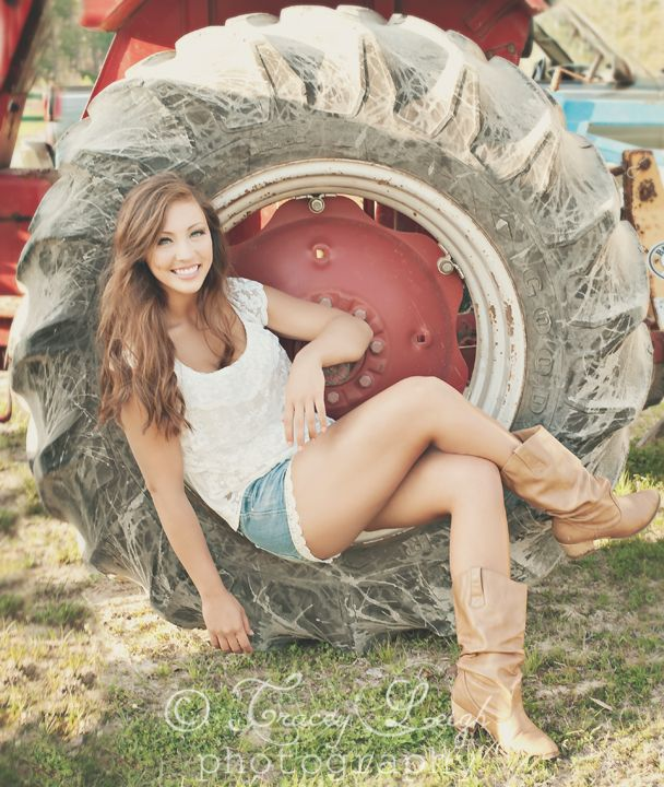 Country Girl High School Senior Portraits #session #inspiration #ideas #props #accessories #poses #photography #photographer #tractor #wheel Tracey Leigh Photography dot com.