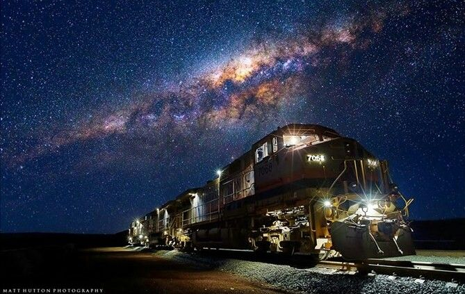 "Under the Milky way... Milky way over Pilbara     Photo Credit : Matt Hutton    Matt Hutton Photography    ""The photo was taken in the Pilbara, that's the Northen region of Western Australia.""    ""This image was made up of a few exposures, one to correctly expose for the milky way, one for the loco and another to expose for the lights and inside the cab! The moon was over my left which provided some nice light!""    www.matthuttonphotography.com"