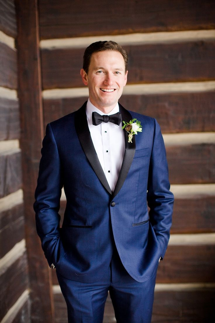 Navy Tuxedo for the Groom at a Winter Wedding!   Read More: http://www.stylemepretty.com/destination-weddings/2014/05/19/elegant-outdoor-vail-wedding-at-the-ritz-carlton-bachelor-gulch/