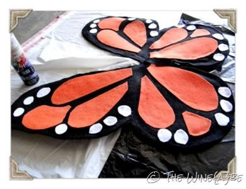 DIY Butterfly Wings DIY Halloween: Use cardboard as a backing and then hot glue gun to attach black felt and then orange and yellow felt over that. Need to also make antennas out of a black headband with attached black pipe cleaners or equivalent + Cape with letters + butterflies to throw