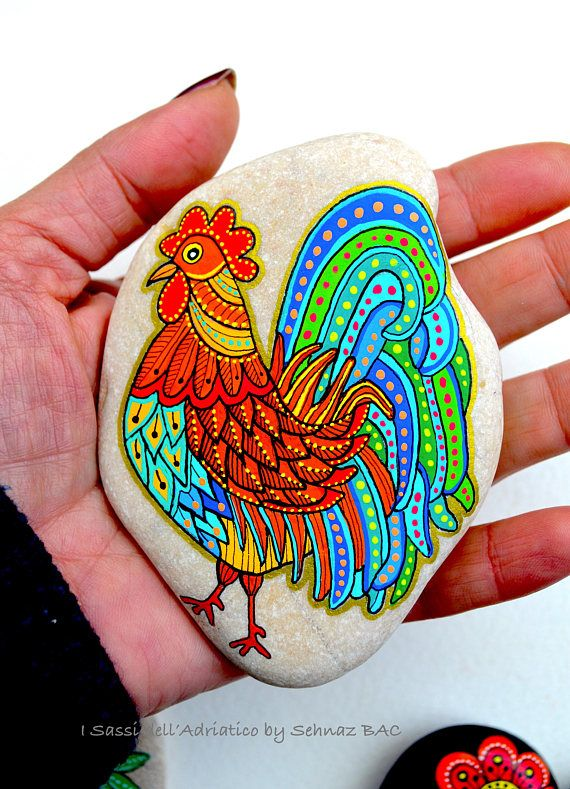 Hand Painted Stone Rooster Beach stone with hand-painted designs in acrylics © Sehnaz Bac 2017 I paint and draw all of my original designs by free hand with high quality acrylic paints, small brushes or paint pens with extra fine tip. I use also different inks. No stencils are