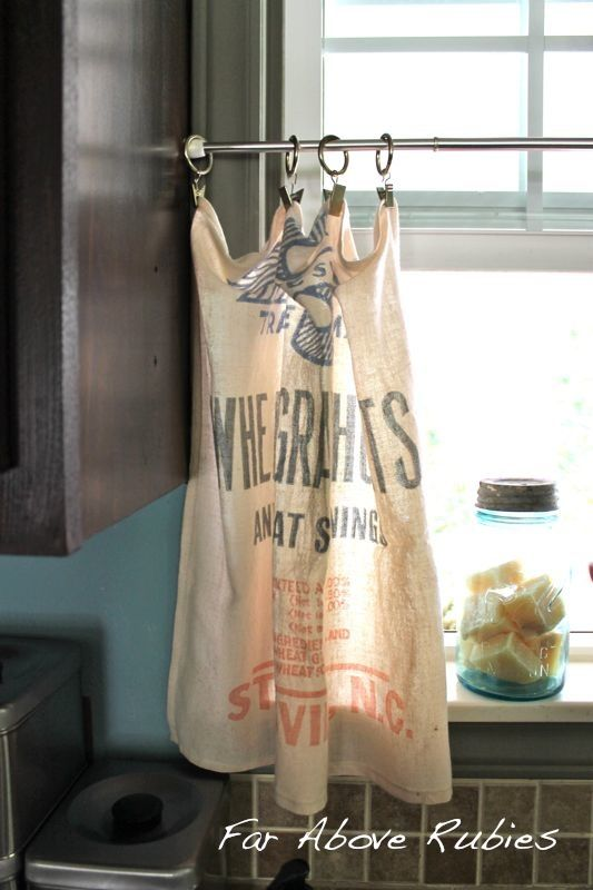 Vintage feed sacks become cafe curtains.  think aprons for small kitchen window or some other kitcheny thing.