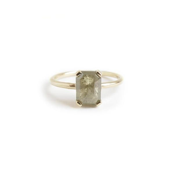 RUMI   The Intent   A one of a kind 9ct yellow gold ring with a four claw channel set emerald cut 1.52ct green/grey diamond.
