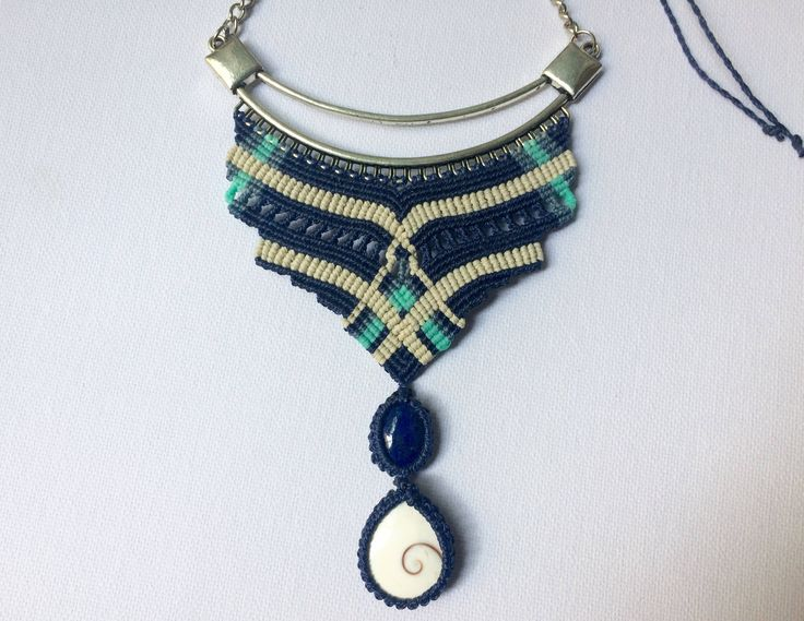 A personal favourite from my Etsy shop https://www.etsy.com/listing/518333998/macrame-bib-necklace-with-lapislazuli