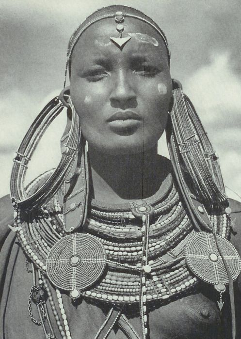 Maasai woman in tradition earrings (each weighing over a pound) signifying that she's married.