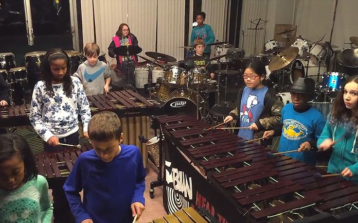 """Children from the Louisville Leopard Percussionists play Led Zeppelin's   """"Immigrant Song"""" on instruments such as marimbas, xylophones and drums"""