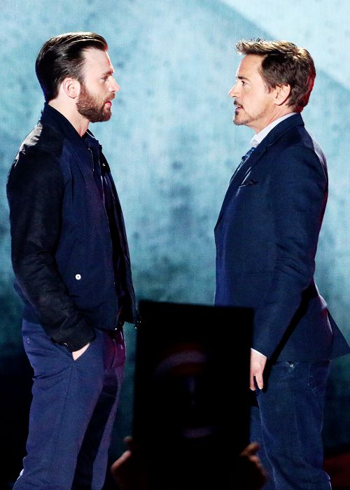 Chris Evans and Robert Downey Jr. onstage at the 2016 Nickelodeon Kids' Choice Awards