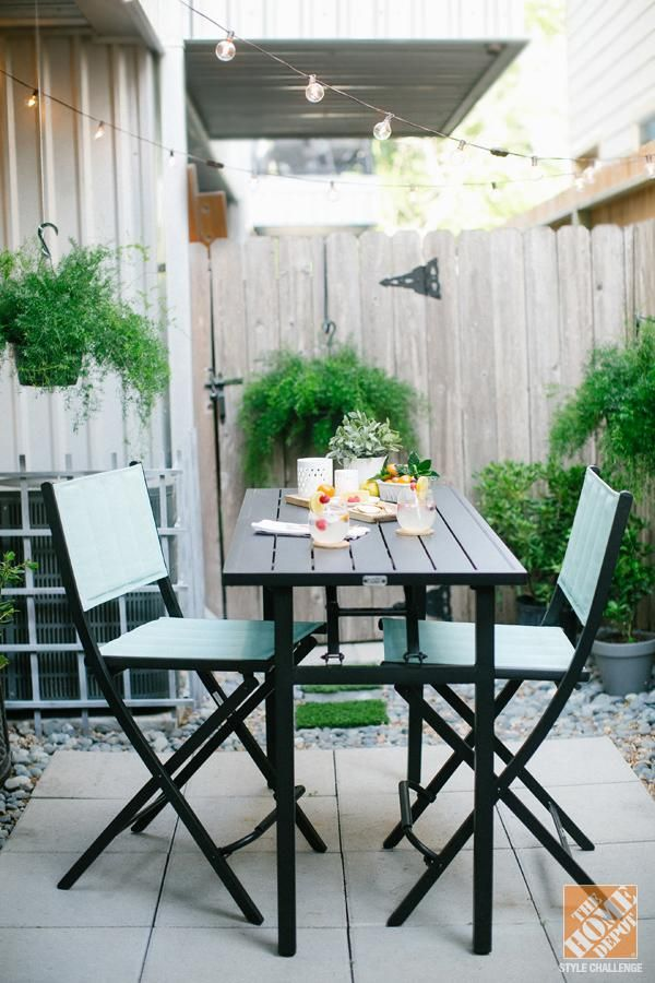 Turn a tiny, urban backyard into a garden retreat with a paver patio and lush, green plants. Blogger Ashely Rose shows you how.    @Ashley Rose / Sugar & Cloth