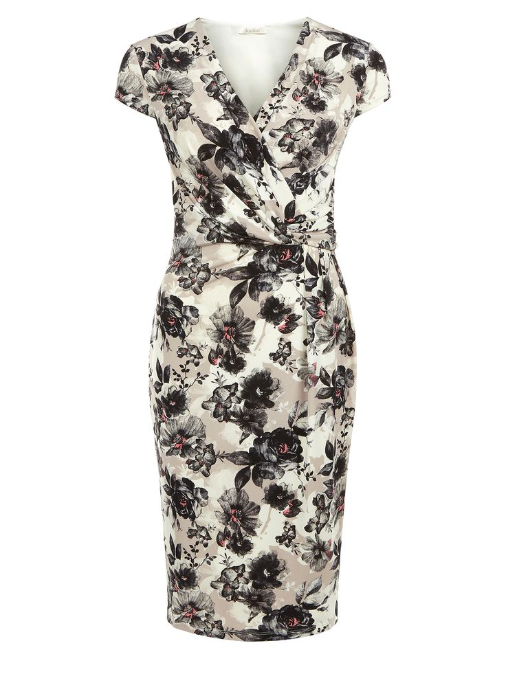 This dress features a V neckline wrap front with twist detailing, and a gorgeous all-over floral print with touches of light pink. A super flattering option for the season. €129.