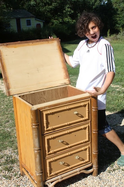 repurpose an old dresser to store quilts and blankets