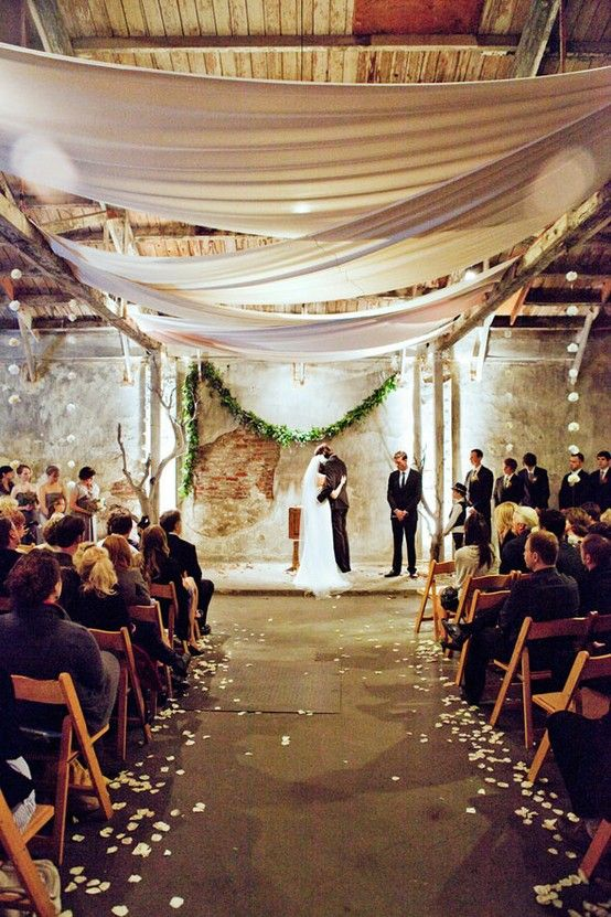 Warehouse wedding, draped fabric, exposed brick, wood... love the textures