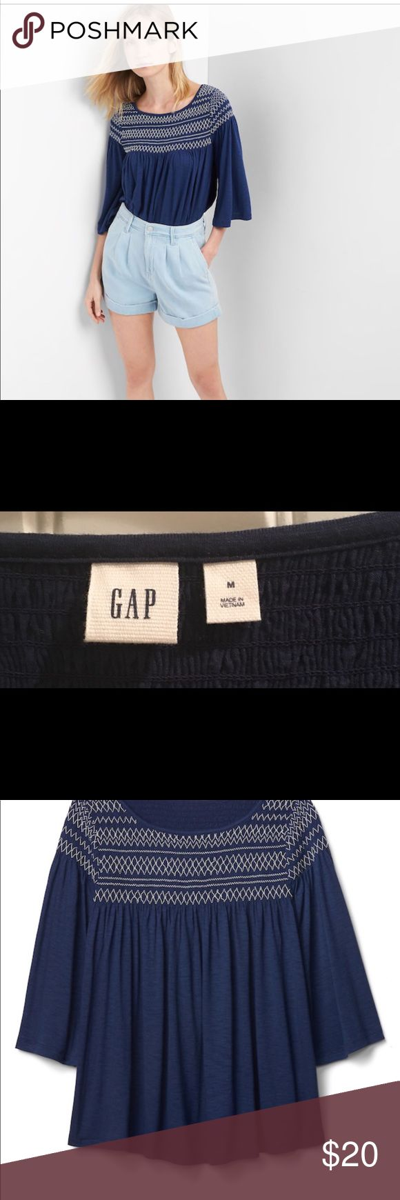 GAP size M shirt Cute smocked top from the Gap. Size M. Navy blue. Super cute and never worn! GAP Tops Tees - Long Sleeve