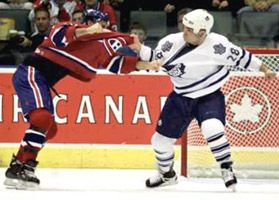 Tie delivers a punch on Montreal Canadians forward Jim Cummins.