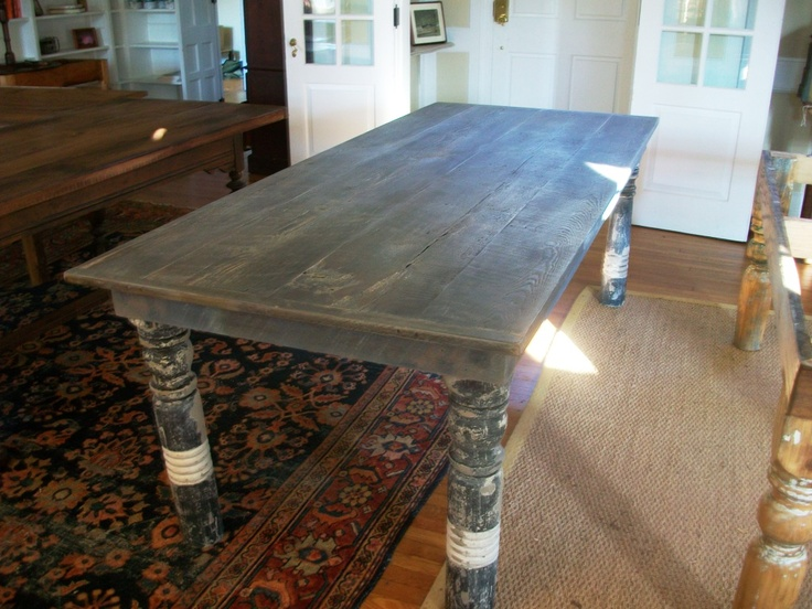 Dining table with distressed Belgian finish amd reclaimed
