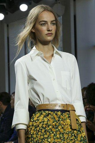 White shirt, flower skirt and brown belt