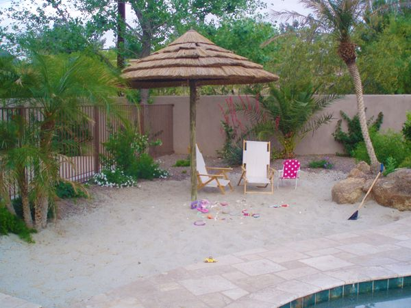 sand backyard | Sandy Beaches, Resort-Inspired Pool Spaces Transform One's Backyard