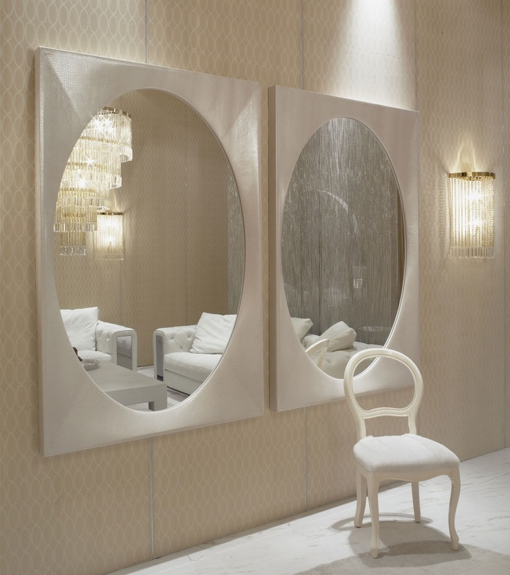 Luxury living room with oval mirror and lighting accent wall design