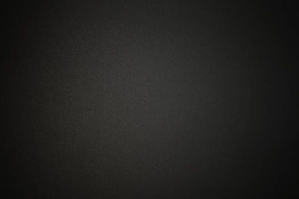 black paper texture background with spotlight