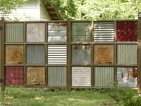 awesome fence idea using metal ceiling tiles - Cool privacy screening! Very