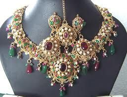 emeralds and rubies in gold