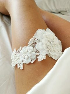 Layered floral single garter embellished with pearls. Email us at sandbco@outlook.com for matching throw garter