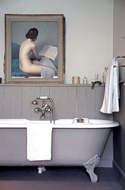 Dreamy painting, claw foot tub, creamy grey color palette. Gorgeous bathroom!