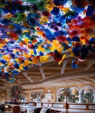 "In the lobby of the Bellagio Hotel. ""Fiori di Como"" is a 2,100-foot chandelier made up of 2,000 handblown, brightly colored glass blooms designed by sculptor Dale Chihuly. More than 100 people worked on the installation, and it required more than 40,000 pounds of glass."
