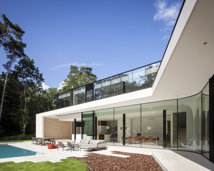 Completed in 2013 in Heusden-Zolder, Belgium. Images by Tim Van de Velde. The house is located in a residential park. One of the most important conditions was a maximum footprint of 250m2 to build in this wooded area. Since...