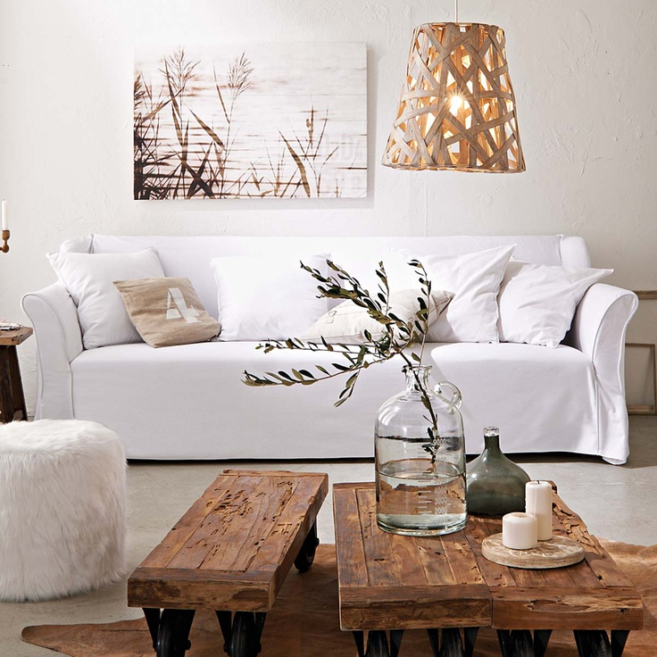 Sofa with rustic wood coffee tables and cowhide rug