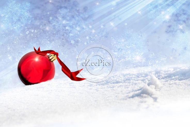 Christmas backgrounds - Red Christmas bauble with red ribbon in the snow. #eZeePics