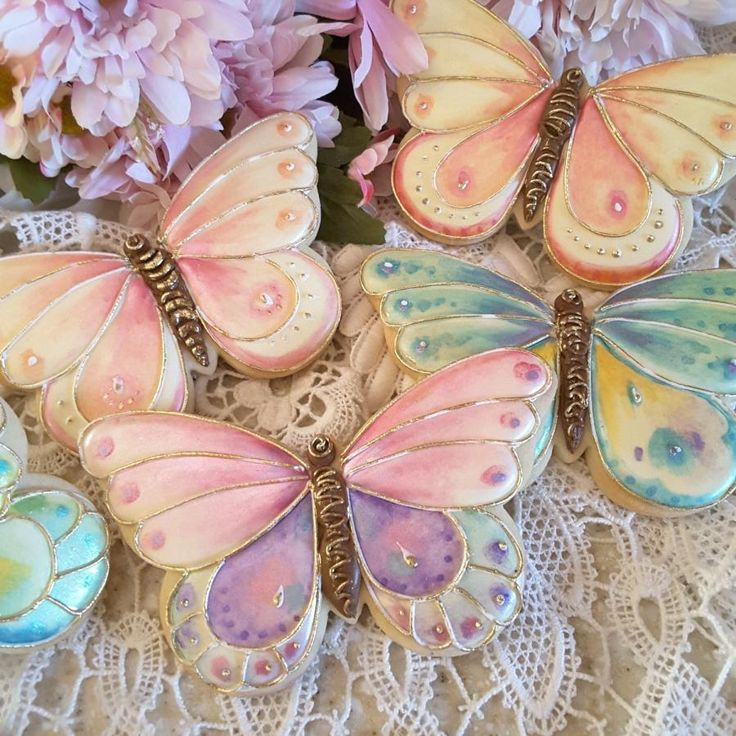 Summer fun butterflies made from sugar cookies and hand painted wIth luster dusts