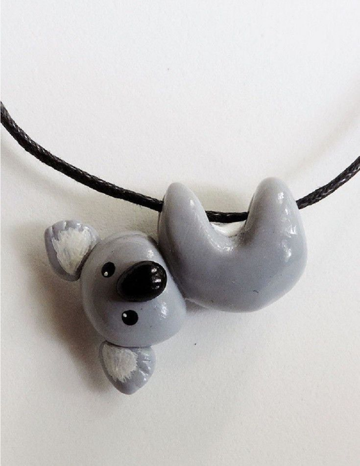Cute koala hanging on a waxed cotton cord necklace.