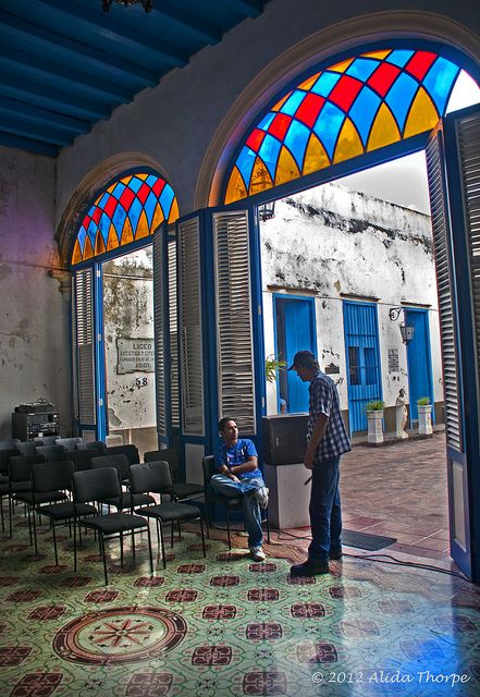 Vitrales (stained glass over doorways) is common in Old Havana from the late eighteenth century architecture.One architectural feature of Cuba is arched windows and doorways, topped with stained glass, and often there are colorful tiled floors.
