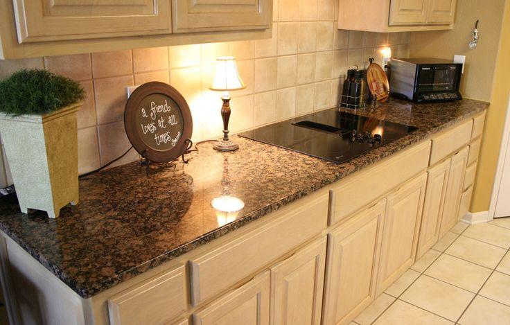 baltic brown granite countertop with large beige tinted backsplash
