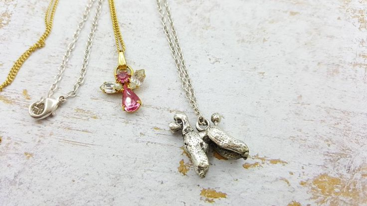 Poodle Pendant in silver tones and pink Angel in gold tones lot of Two.