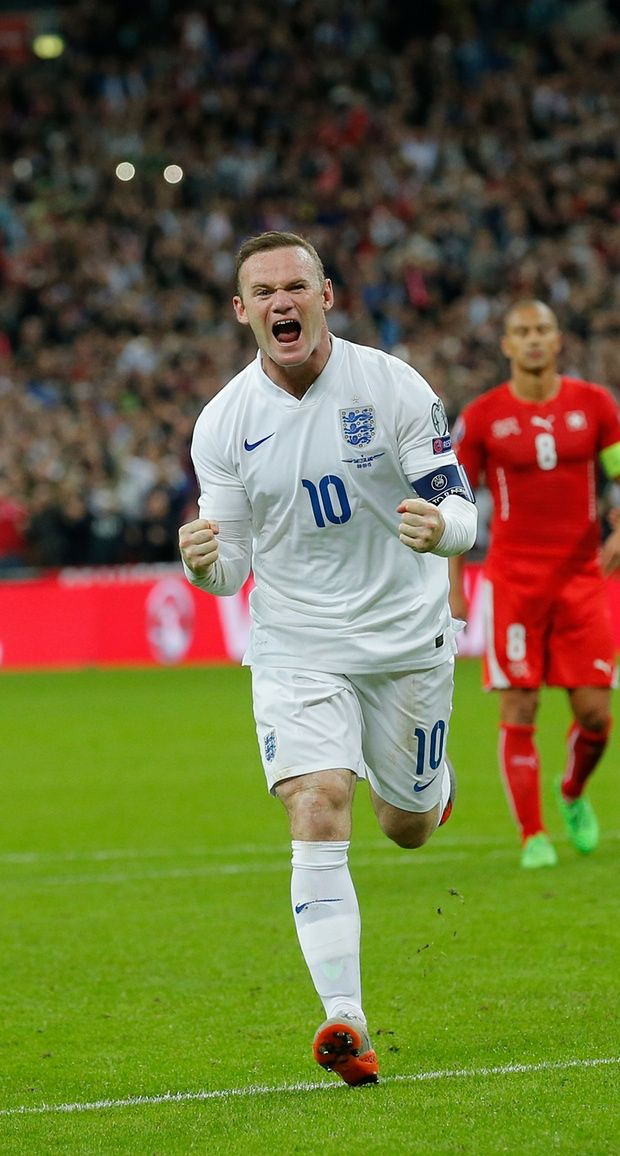 Wayne Rooney celebrates beating the record held by Bobby Charlton, to become England's top scorer.
