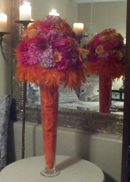 Feathers and boas orange hot pink tall centerpiece