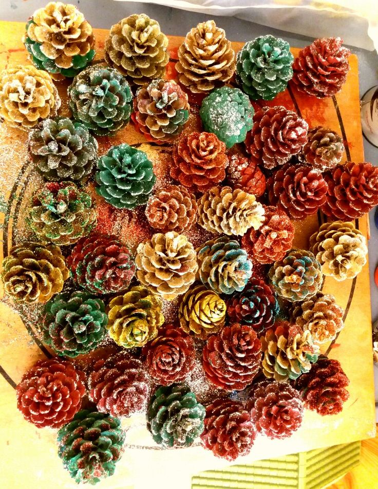 Christmas decorations. Painted  Pine cones and glitter.