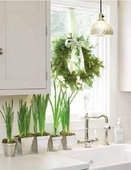Wreath in kitchen window above sink