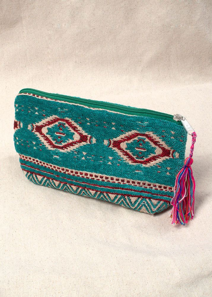 This teal aztec zip up pouch will quickly become one of your versatile favorites…