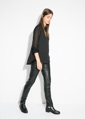 stud faux leather trousers