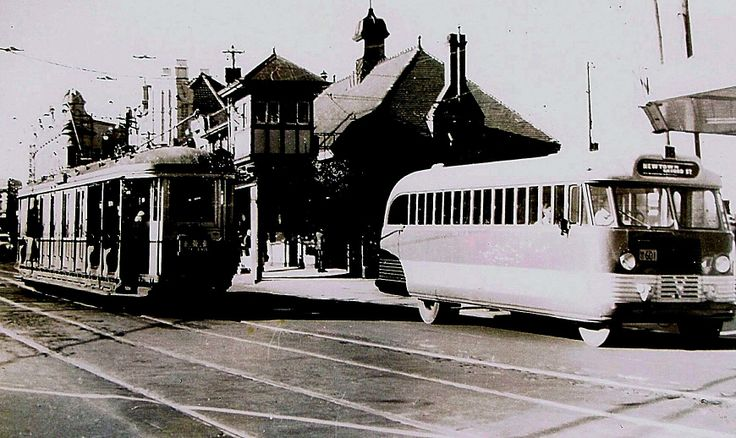 An electric tram and motor bus together at Newtown Railway Station, Sydney. ca.1950's. v@e.