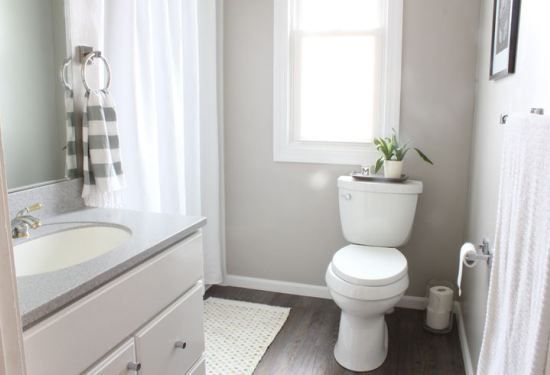 collonade gray sherwin williams is the perfect gray paint colour with a greige undertone. Shown in this bathroom with wood look floor