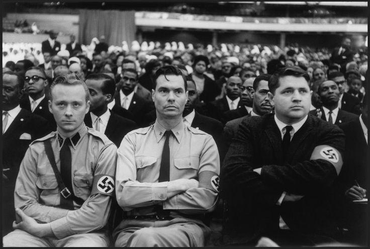 George Lincoln Rockwell (center), leader of the American Nazi Party, with two colleagues present at the Congress of the Nation of Islam, where they listened to a speech by Malcolm X.